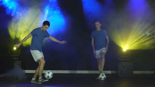 two boys juggling ball