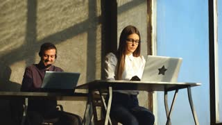 two Customer support operator working in a call center