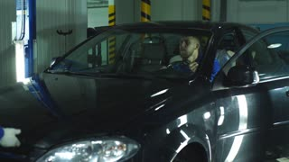 two engineer mechanic test the car