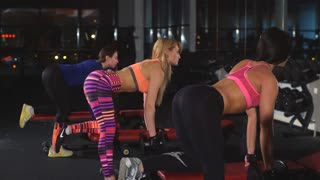 two girls doing exercise on your triceps with dumbbells