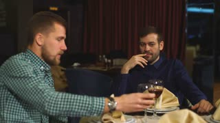 two men on a business dinner, drink wine