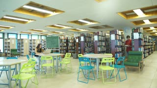 two students learn in the library