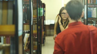 two students met in the College library and discuss the lecture