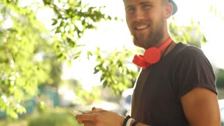 Urban smart casual handsome young man talking on smartphone