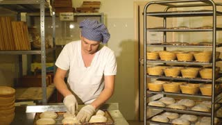 a Baker makes manual incisions on the dough for the bread. The Manufacture Of Bread. Bakery