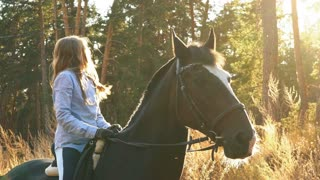 A Beautiful and natural young girl outdoors with horse