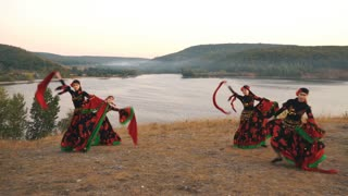 a group of girls in bright costumes dancing Gypsy on the hill