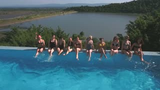 a group of women on the edge of the pool