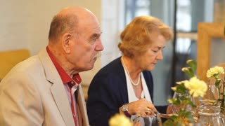an elderly couple has dinner in the restaurant
