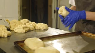 Baker preparing dough for bread