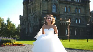 beautiful blonde bride goes on camera and posing