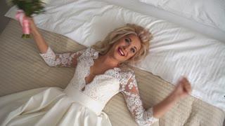 beautiful bride blonde have fun in bed