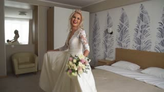 beautiful bride falls on the bed