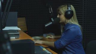 Beautiful Radio DJ in studio talk with audience