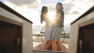 beautiful young couple on yacht