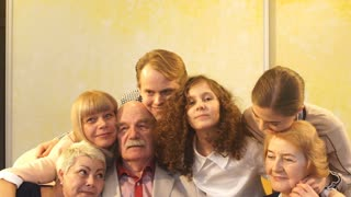 big family hugging in slow motion