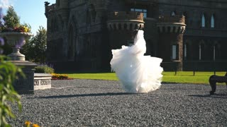 bride in beautiful dress spinning