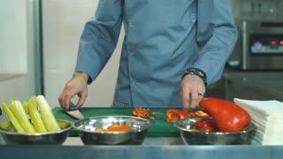 chef cooking food kitchen restaurant cutting pepper