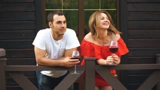 couple in love drinking wine on the veranda