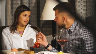 Couple On Romantic Date. Couple In Love Embracing And Drinking wine In Cafe