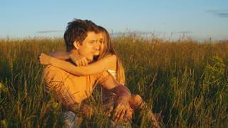 Couple sitting and watch beautiful sunset