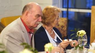 elderly couple dining in a restaurant