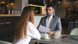 employer asking some particular questions to one of young applicants during interview