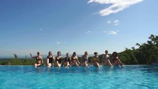 Girls relaxing in pool