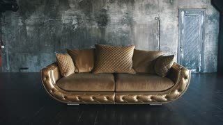 Gold leather sofa in loft on background