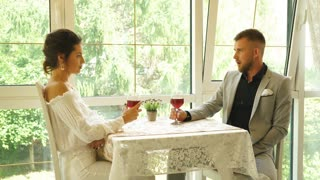 happy couple in restaurant looking each other and toasting