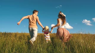 happy family running on the field