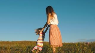 happy mother turns daughter's hands,