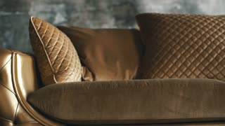 Luxury golden sofa on a loft background