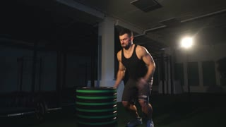 Man doing box jump exercise at gym