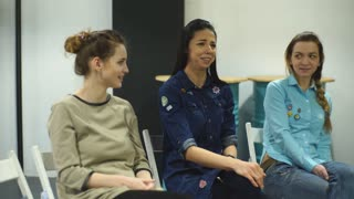 three young women at the psychological training