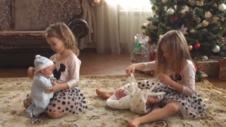 Twin little girls with presents