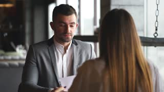 Young woman having a job interview with a corporate manager in his office