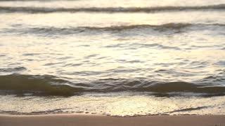 waves on beautiful sunset