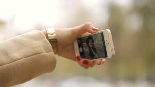 Woman using smart phone take a selfie