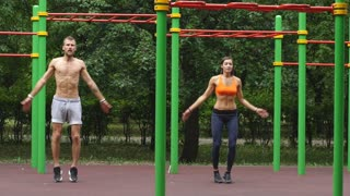 Workout - young couple jumping together
