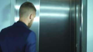 young and successful businessman gets in an Elevator