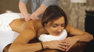 young brunette woman getting a back massage