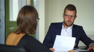 young businessman discussing the terms of the contract with businesswoman in office