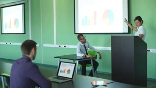 young businesswoman showing a presentation to his colleagues