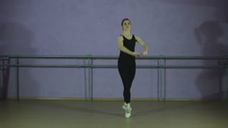 Young caucasian ballerina girl showing various ballet steps and positions