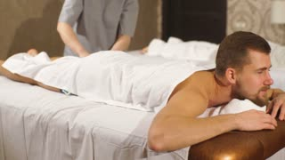 young couple doing massage