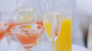 A waiter with a tray of glasses of champagne, delicious apple punch