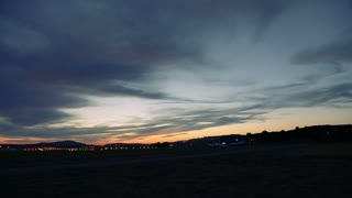 Airplane landing at Airport at sunset in Switzerland