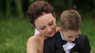 Bride and baby playing outdoor