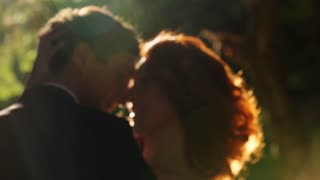 bride and groom embracing tenderly